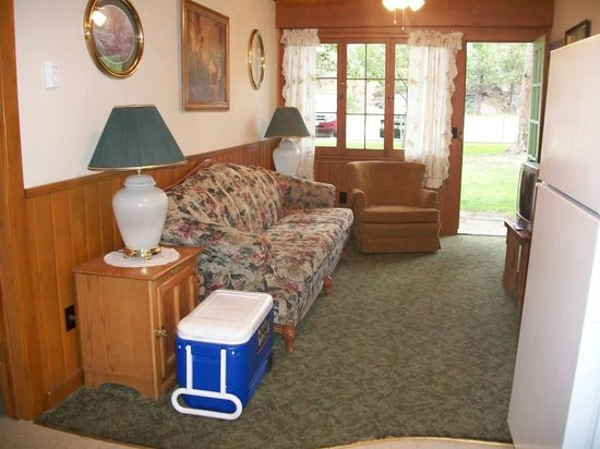 Loveland Heights Cottages: Standing at table looking to front of cabin.
