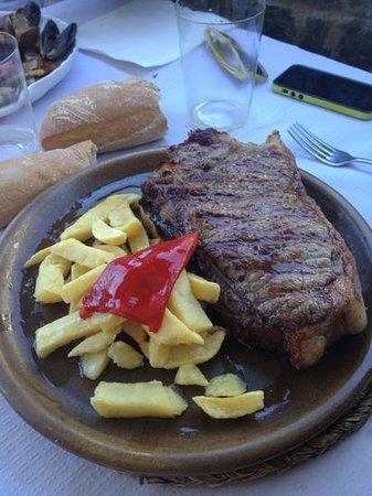 Chulet n de buey fotograf a de restaurante la roca for Restaurante la roca