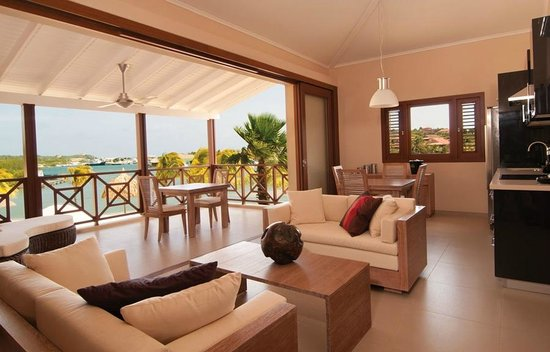 La Maya Beach Luxury Apartments: Spacious living room with sliding door and adjoining porch