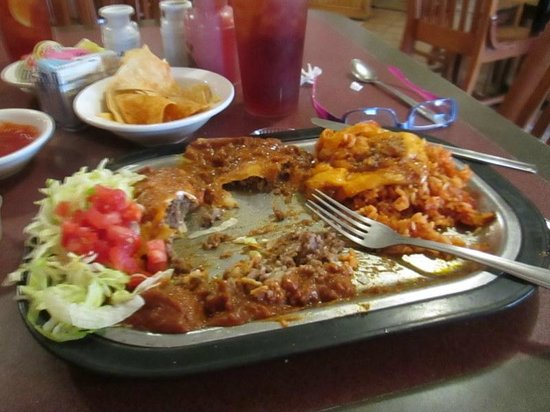 Plaza Restaurant: Enchilada plate with blob of cheese removed to the side, dark ikky sauce