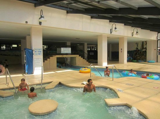 The Breakers Resort: View of one hot tub and lazy river underneath Paradise Tower.