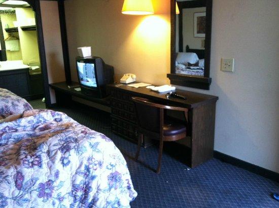 Legacy Inn Suites: shelf tv is sitting on is loose