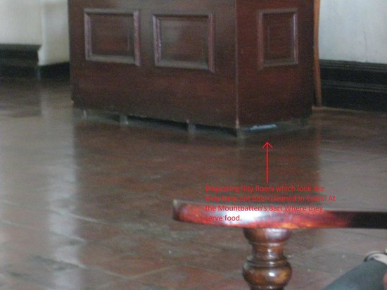 Queens Hotel: Years and years and years of dusty floor underneath this table in Mountbatten's bar