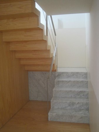 Flattered To Be In Porto: Stairs in apartment leading to sleeping quarters, bathroom.