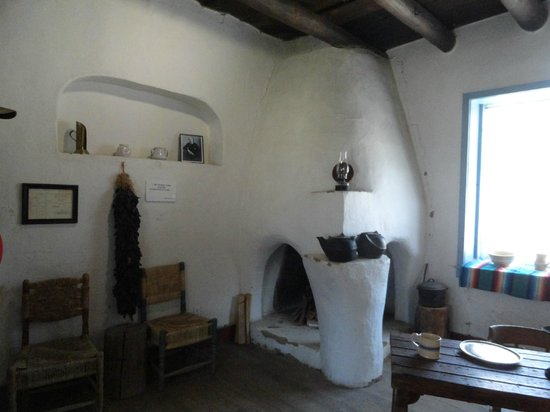 Kit Carson Home & Museum: Room with a fireplace
