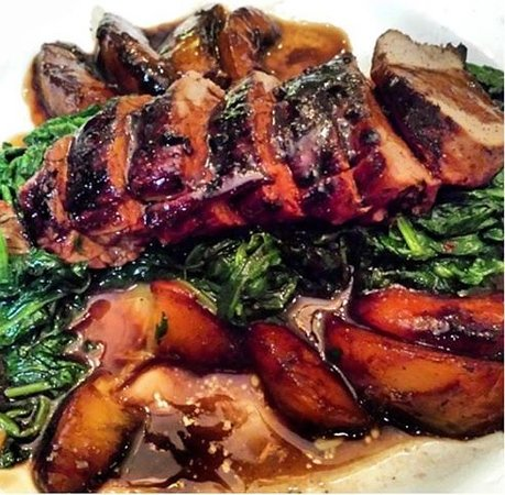Casa Dante : Pork loin, peaches over sautéed spinach