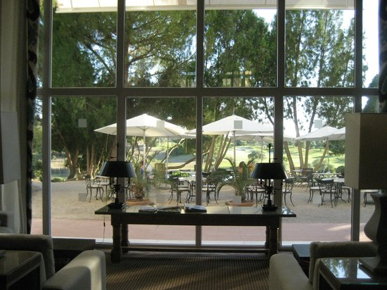 Barceló Montecastillo Golf: View from inside seating area to outside seating and bar area