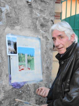 Sportelli d'arte : Francesco Lorenzini al lavoro in Via Sant'Apollinare