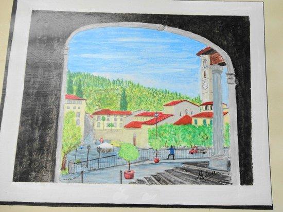 Sportelli d'arte : Piazza Mino da Fiesole da sotto il portico della Canonica