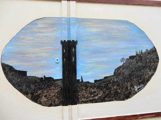 Sportelli d'arte : il campanile della Cattedrale visto da Via Verdi