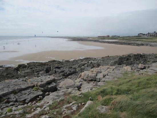 looking at royal porthcawl golf club house from across beach