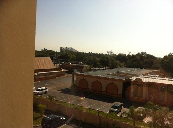 Holiday Inn Express & Suites Tampa USF-Busch Gardens : View from room of park rides.
