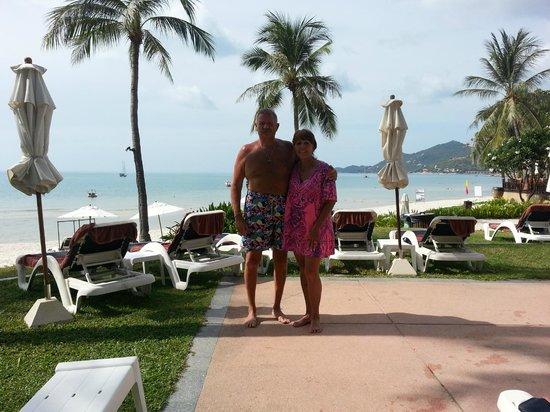 Centara Grand Beach Resort Samui: Linda and I early morning poolside with adjoining beach