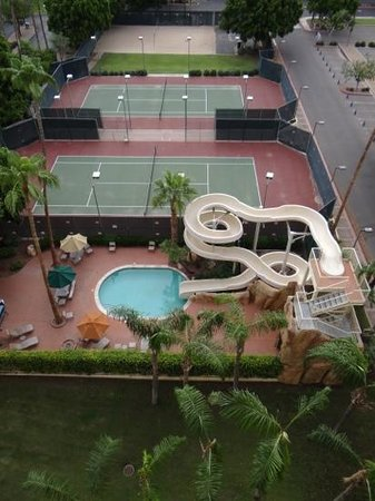 Sheraton Crescent Hotel: water slide and tennis courts from our room