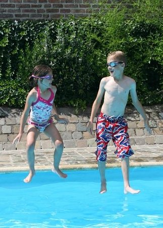 Novotel Gent Centrum: Our children enjoying the lovely courtyard pool