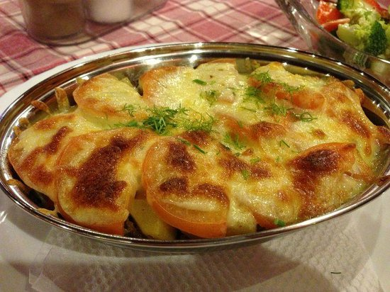 USSR: Baked beef with tomato slices and potatoes draped in cheese