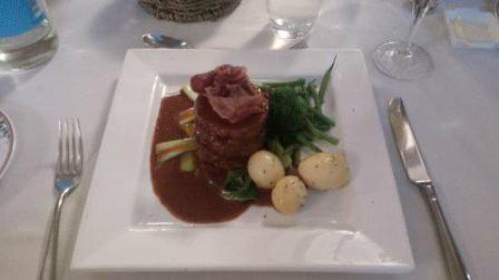 Comme Ca Restaurant: La Poitrine de Porc Roulee. I'm salivating just looking at that...