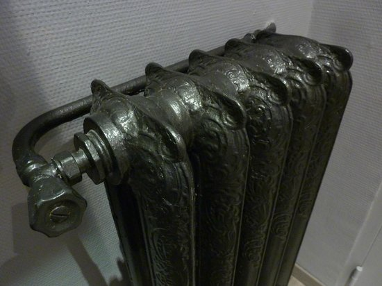 Hotel Lemon: Original Cast Iron Radiator / Heater