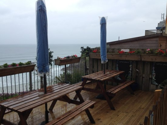 The Cod End Fish & Chip Shop: patio rear view overlooking bay