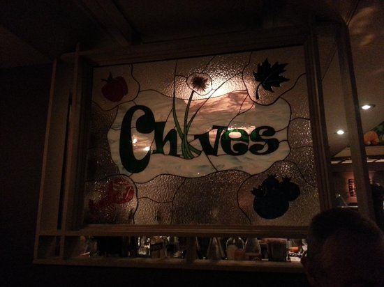 Chives Canadian Bistro: Stained glass window signage inside