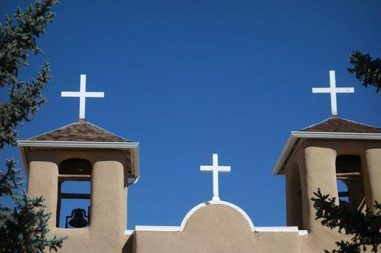 San Francisco de Assisi Mission Church: White crosses against that blue NM sky