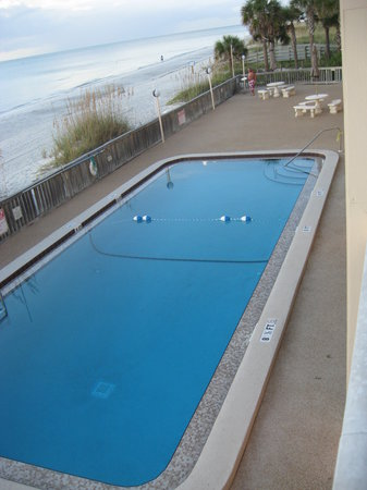 Fifty Gulfside Condominiums: view from room onto deck with heated pool.