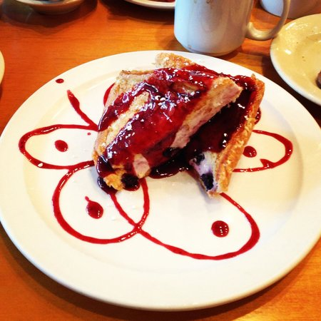 Palmetto Bay Sun Rise Cafe: Too pretty to eat. Blueberry cream cheese French toast. But-- we ate it!