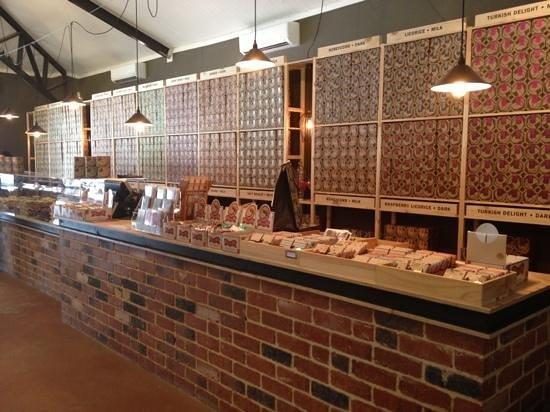 Whistlers Chocolate Co: Chocolate counter - chocolate wall.