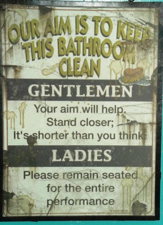 Slow Groovin' BBQ: Above the toilet in the Slow Groov'n BBQ Restaurant. lol
