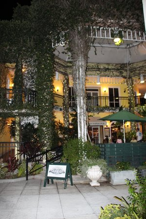 Old Naples Pub: A view at night of the outdoor seating area.