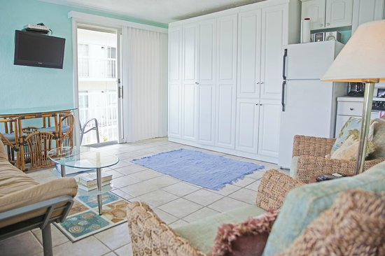 Coral Resort Condominiums: Murphy bed tucks away in the white cabinets when not in use