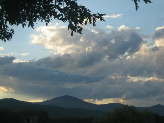 Oxford House Inn: Clouds over White Mountains from backyard