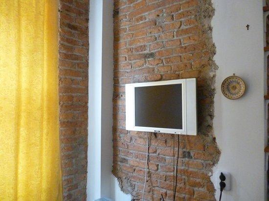 Downtown Apartments Brasov : salon coin tv