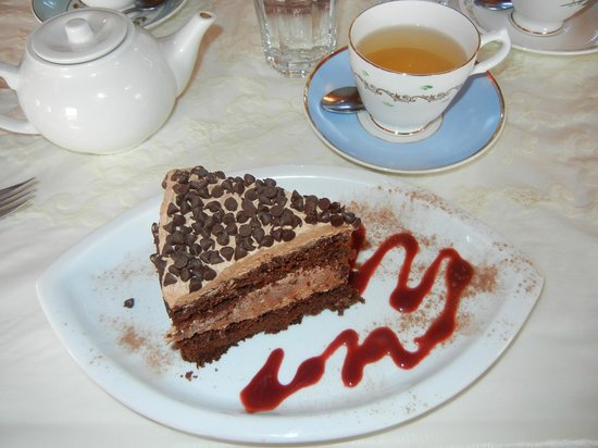 "The Red Door Tea Room: This slice of cake was over 5"" tall and bursting with yumminess"