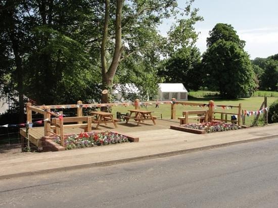 The Royal Oak Village Pub & Kitchen: Decking over looking the village green opposite The Royal Oak
