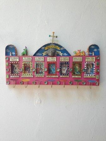El Diablo y La Sandia Libres: Handicraft hanging on the patio wall