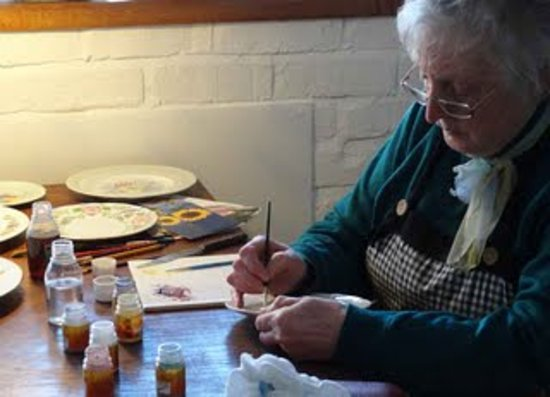 The Spode Museum Trust Heritage Centre: Pauline demonstrating painting on ceramics