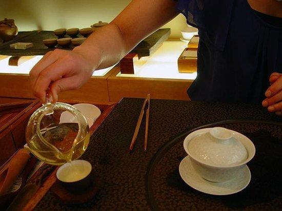 Red Blossom Tea Company: Pouring a sample of the 2013 longjing tea