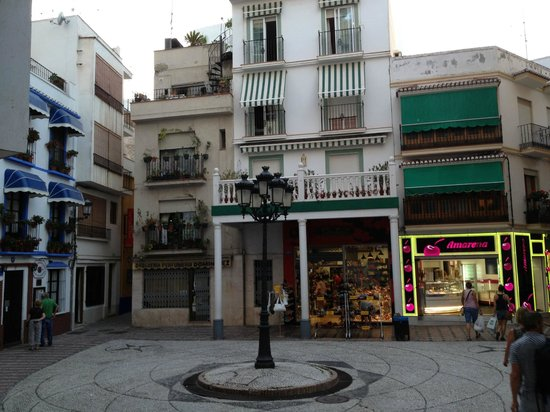 Hostal Altamar de Almunecar: plaza near to the hostel; the street of the hostel is the narrow one on the left of the photo