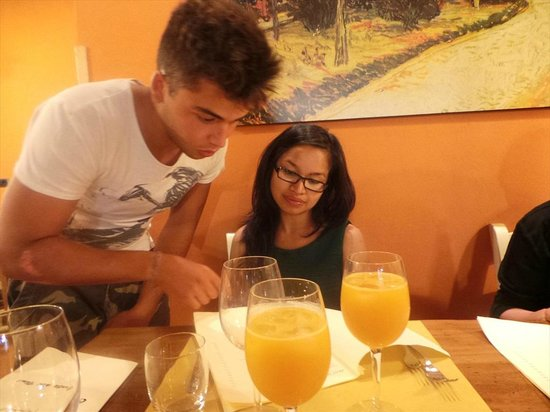 Tiberio Trattoria: son of the owner explaining to my daughter in English the menu