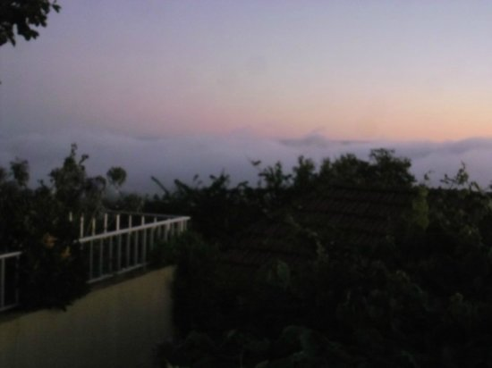 Summerplace Guesthouse: seeing weather form from the terrace of our room, above clouds