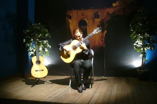 Advertisement for Cecilia Morales - traditional flamenco guitar: fotografía d...