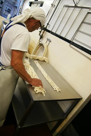 Vella Cheese Company: Cheesemaker at work