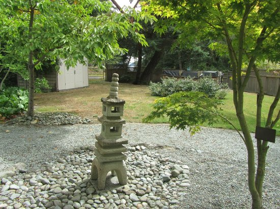 Japanese Garden: Small Stone Pagoda At Centre Of Yin Yang Symbol
