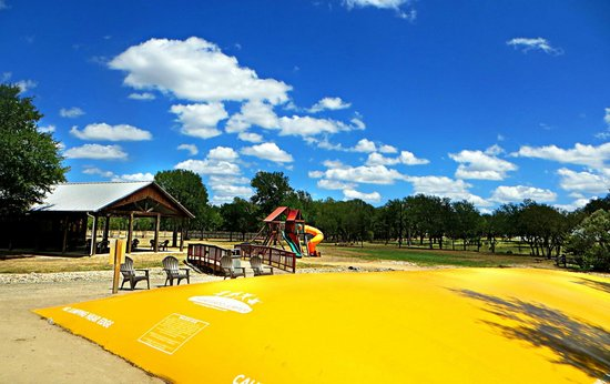 Jellystone Park Texas Wine Country Camping Resort: View of jumping pillow and playground