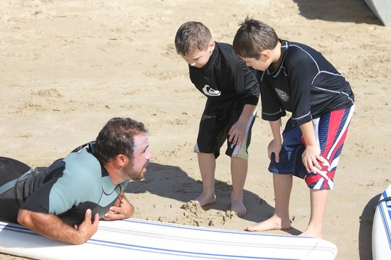 Boarding House Surf School: Getting tips from Carlos on how to paddle and pop up
