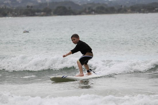 Boarding House Surf School: Our six year old surfing after his lesson!