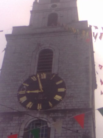 About Cork Taxi Tours Day Tours: Barry Searle  waving from the famous 4 faced liar the clock tower st annes shandon