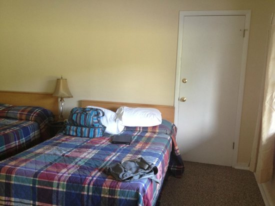 Blue Ridge Motel: lumpy bed- door in view is to the adjoining room, which made me a tad uncomfortable
