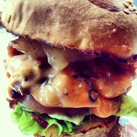 Le Gourmet Burger: charcoal grilled bison burger with Gouda, mushrooms and pink Russian sauce!